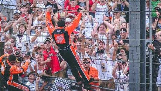 Tony Stewart Climbing the Brickyard Fence
