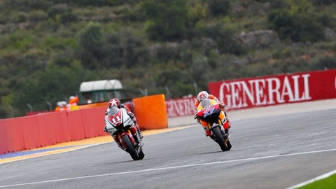 Stoner rounds off 2011 title with Valencia victory