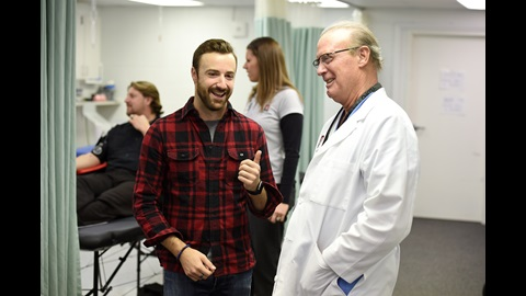 Verizon IndyCar Series driver James Hinchcliffe greets Trauma Surgeon Timothy H. Pohlman M.D., who helped stabilize James during May of 2015, at a Blood Drive put together by the IndyCar driver