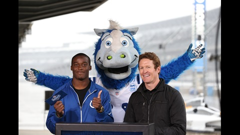 With the help of Colts Mascot Blue the 2015 Indianapolis Colts first-round draft selection Phillip Dorsett and 2008 Indianapolis 500 Champion Scott Dixon announce a draft selection at IMS