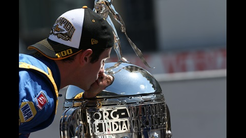 Alexander Rossi kisses the Borg-Warner trophy after winning the 100th Running of the Indy 500 presented by PennGrade Motor Oil